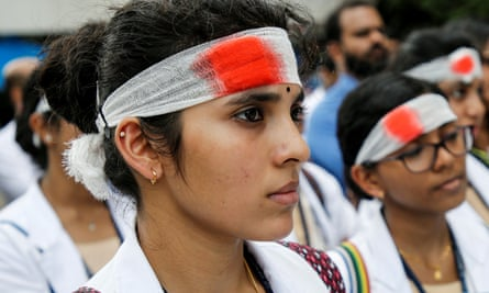 Medical students wear mock bandages during a protest in Kochi
