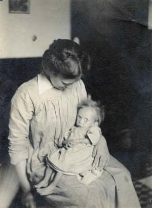 Nurse Maud Hebbes holding a malnourished child