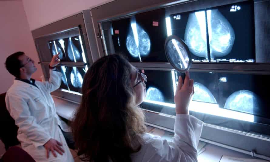 Medical staff study mammograms