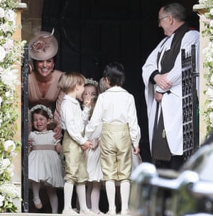 Kate, Duchess of Cambridge, stands with her daughter, Princess Charlotte, and other children in the wedding party.