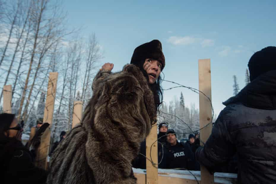 Sabina Dennis stands her ground as police dismantle the barricade to enforce the injunction filed by Coastal Gaslink Pipeline at the Gidimt'en checkpoint near Houston, British Columbia on Monday, January 7, 2019. The pipeline company were given a permit but the Office of the Wet'suwet'en, who have jurisdiction over the territory in question, have never given consent.