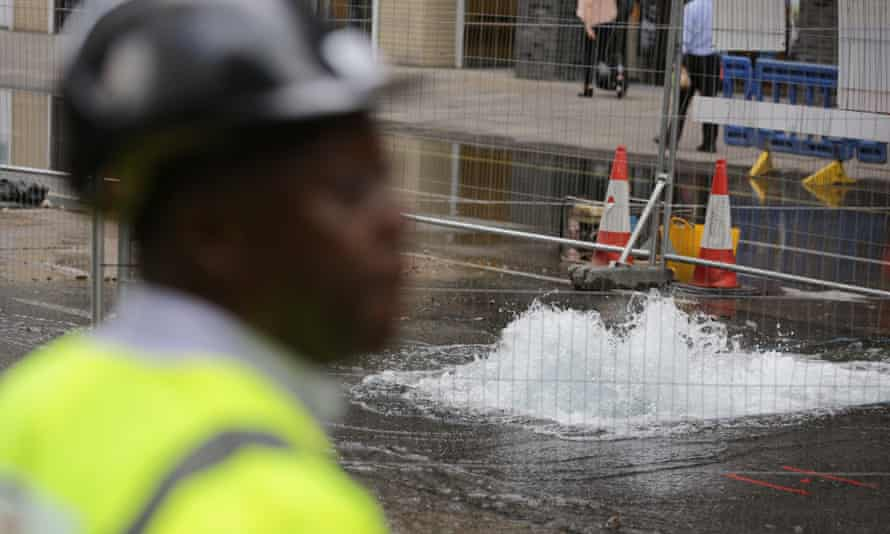 A burst water main on Victoria Street in Westminster, London