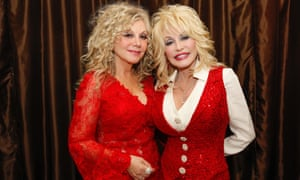Stella Parton, left, and Dolly Parton at the Red Tent conference in 2014.