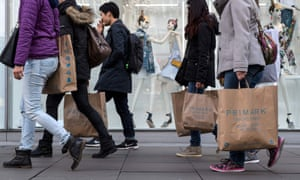 Shoppers walking past a store on Oxford Street in London