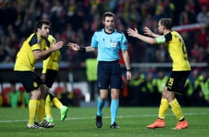Sokratis and Marcel Schmelzer argue with referee Nicola Rizzoli.
