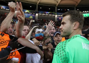 Russian supporters shout at Russia goalkeeper Igor Akinfeev after their Euro 2016 exit at the Stadium municipal in Toulouse, France, Monday, June 20, 2016.