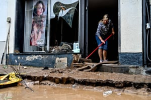 A woman mops a shop entrance after flooding in Bad Münstereifel, Germany. Large parts of North Rhine-Westphalia were hit by heavy, continuous rain, resulting in local flash floods