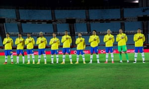 The Brazil players line up before their match against Uruguay at the Estadio Centenario in Montevideo.
