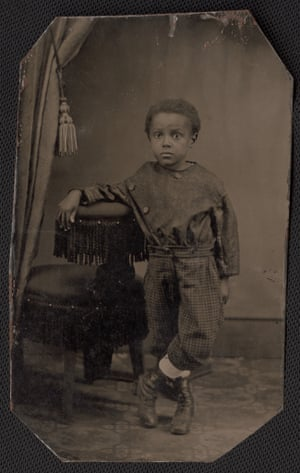 Portrait of child leaning on chair