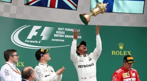 Mercedes' Lewis Hamilton celebrates victory on the podium.