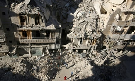 People dig in the rubble in an ongoing search for survivors at a site hit previously by an airstrike in the rebel-held Tariq al-Bab neighborhood of Aleppo, Syria on Monday.