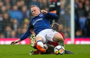 Liverpool's Sadio Mane tackles Everton's Wayne Rooney during the goalless Merseyside Derby at Goodison Park.