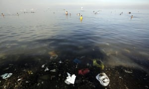 People cool off in the polluted waters of Manila Bay in the Philippines
