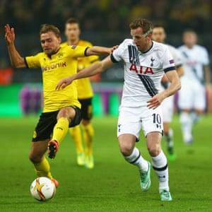Marcel Schmelzer holds off Tottenham's Harry Kane.
