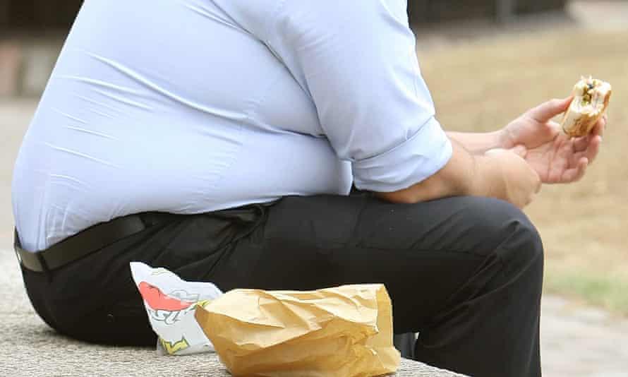 A man eating junk food