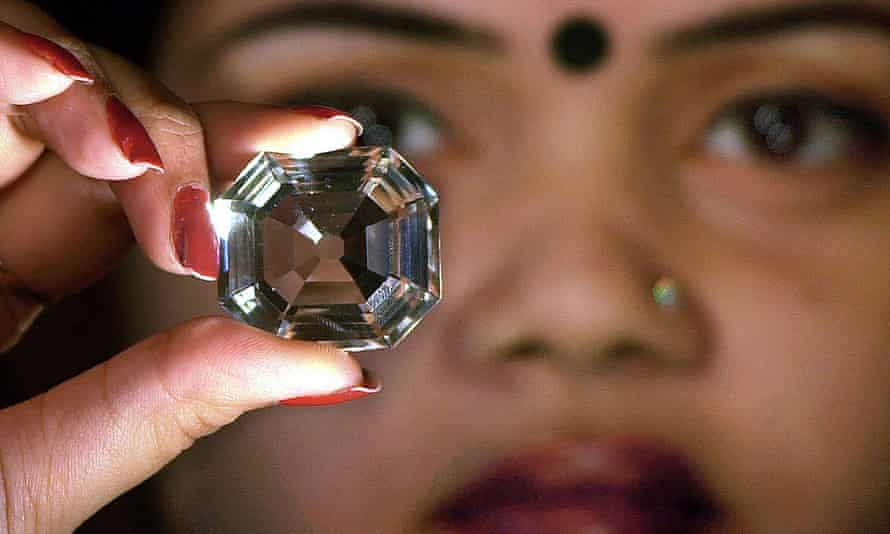 A model holds a replica of the Koh-i-noor diamond in Calcutta.