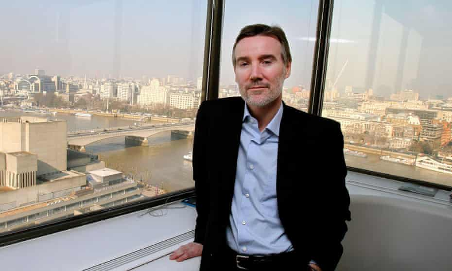 Adam Crozier beside a window overlooking the Thames