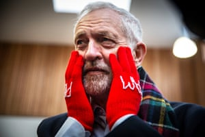 Glasgow, Scotland Labour leader Jeremy Corbyn wears gloves with the inscription 'Pick Pam' to support candidate Pam Duncan-Glancy during a visit to the Heart of Scotstoun in Glasgow