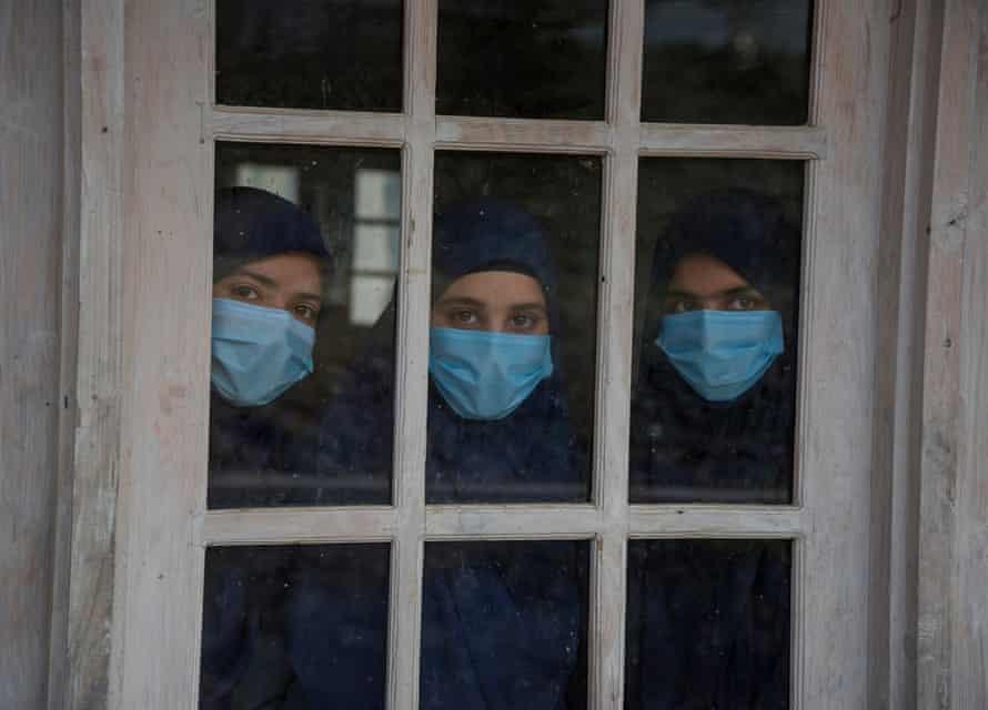 Iqra, Mubashira and Rizwana look out of a window of their class, Baramulla.