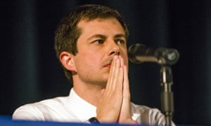Pete Buttigieg looks on during a town hall community meeting where he faced criticism after the shooting.