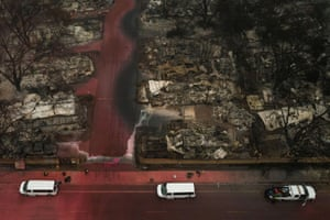 A search and rescue team looks for victims in the aftermath of the Almeda fire in Talent, Oregon Sunday.