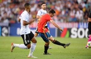 Spain's Fabian Ruiz scores their first goal.