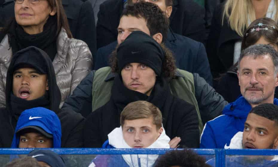 Chelsea's David Luiz, centre, watches Sunday's match against Manchester United from the stands after being dropped from the squad by his manager, Antonio Conte.