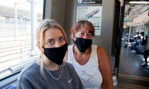 Tanja, right, and Cora Van Wyngaardt were among those to comply with the compulsory wearing of face coverings on public transport.