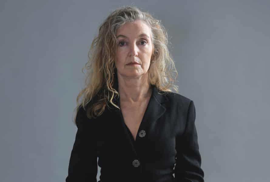 Head shot of writer Rebecca Solnit, against grey background, photographed in 2017