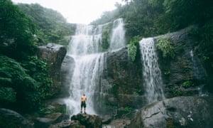 Man with jungle waterfall