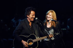 Springsteen performing with his wife, Patti Scialfa, in 2005.