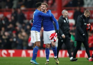Leicester City's James Justin and James Maddison celebrate after the match.