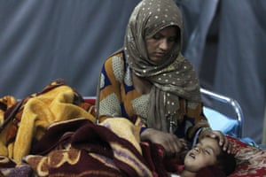 Qaim, Iraq A mother watches over her wounded child