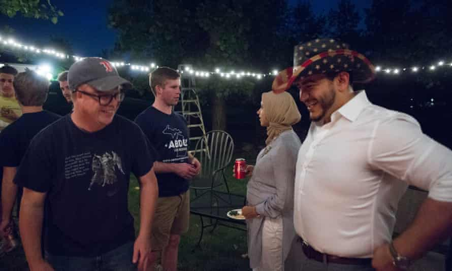 The Michigan Democratic gubernatorial candidate Abdul El-Sayed, right, wears a novelty cowboy hat during a cookout in Ann Arbor in August 2017. The Democratic primary will take place on 7 August 2018.