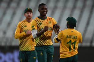 South Africa's Lungi Ngidi celebrates with Temba Bavuma after they combined to dismiss Eoin Morgan.