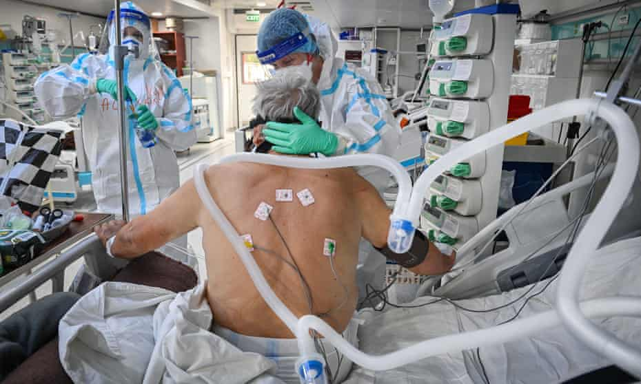 A coronavirus patient is treated in Bucharest, Romania.
