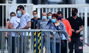 Employees at a meat company that was closed due to coronavirus outbreaks.
