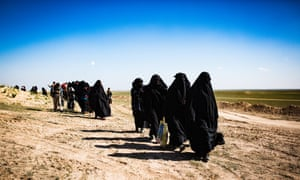 Women and children arrive at a civilian screening point for Isis families fleeing fighting in the city of Baghuz.
