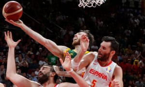 Australia's Nic Kay in action with Spain's Rudy Fernandez and Marc Gasol.