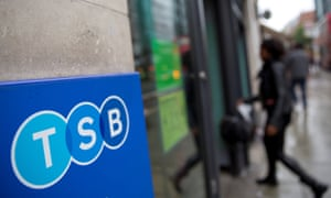 A woman wlalks into a branch of TSB bank in London.