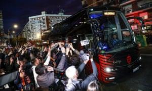 Valencia supporters congregate to greet their team outside the Estadio Mestalla before kick off.