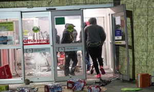 Looters ransack an Office Depot store during protests on Friday night in Minneapolis.