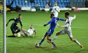 Jamie Vardy rolls the ball into an empty net.