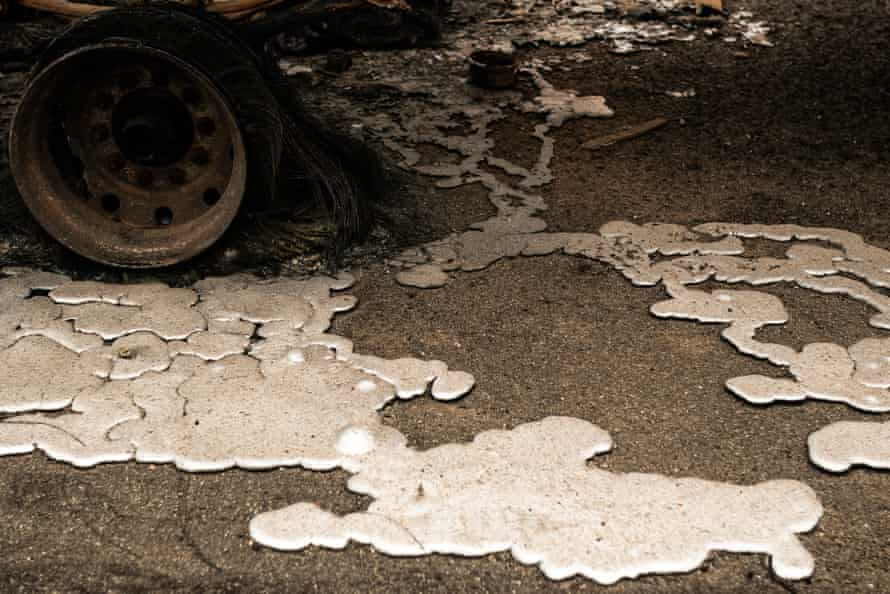 Melted metal on the ground at a burned-out lumber yard on Thursday in Molalla.