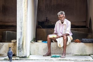 By George Kerridge. A worker enjoys a well-earned lunch break from doing the laundry at Dhobi Khana, Fort Kochi, Kerala, India. It was early afternoon and the place wasn't particularly busy.