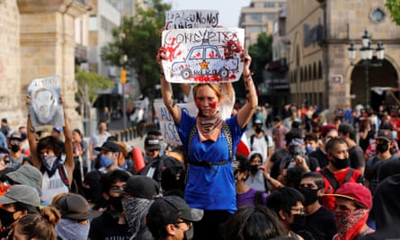 A protester holds up a sign in Guadalajara, Jalisco, during a rally on Saturday.