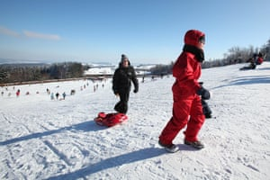 Sledging in the snow at Baraque Fraiture, one of the highest points of Belgium.
