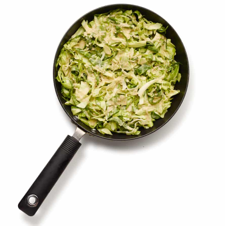 How to make the perfect okonomiyaki: step 4 cover with cabbage.