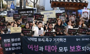 Anti-abortion activists shout slogans in front of the court in Seoul