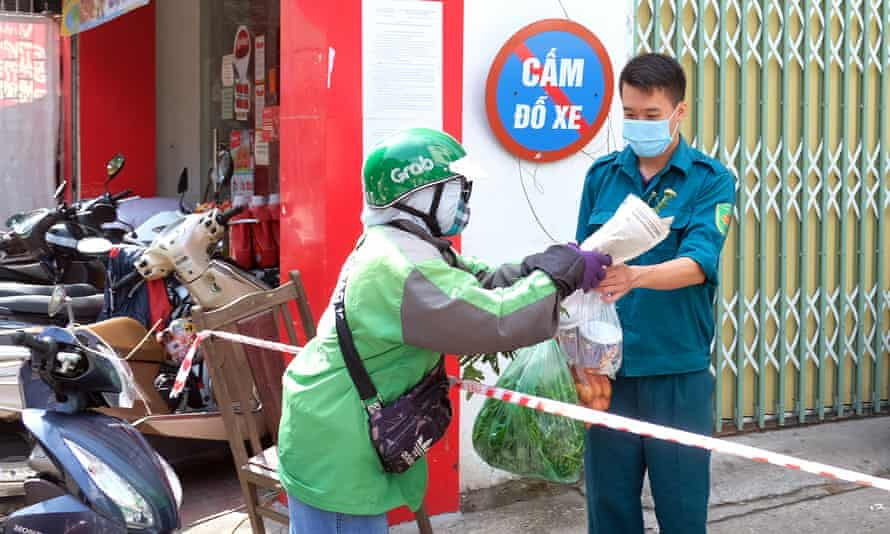 A man receives food supplies inside a quarantine area in Hanoi, Vietnam, on 26 May.